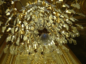 Looking up from directly under a chandelier