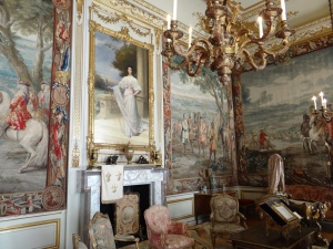There are numerous tapestries that were commissioned by the original duke from Belgium depicting his military victories and made specifically for these walls.  It took 14 years to complete working day AND night