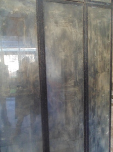 They have placed these charred wooden doors in lass to protect them.