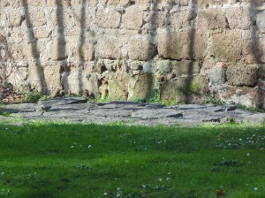 Old stones from the ancient Roman road that the Vatican wall was built over.